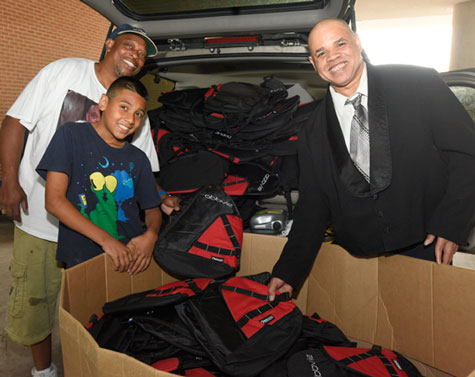 Big Will (on the right) and two of his helpers collect  leftover backpacks at the 2015 BIO International Convention