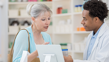 Woman speaking to pharmacist